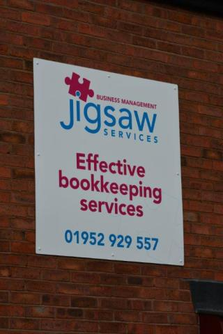 Jigsaw wall mounted Dibond sign